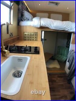 Mercedes sprinter camper van conversion. Kitchen, bathroom and bedroom